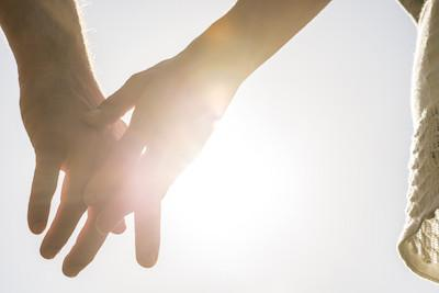 Close up of a couple holding hands in the sun | Couples Counseling Federal Way WA