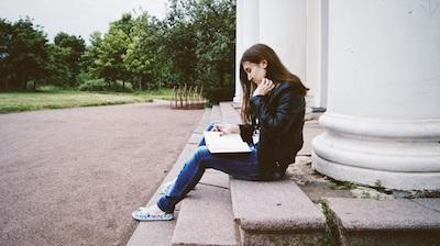Teen Girl Reading Diary on Steps | Teen Counseling Federal Way WA