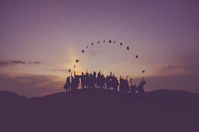 Groups of kids in distance throwing graduation caps | Supporting Neurodiversity: Kids and Teens