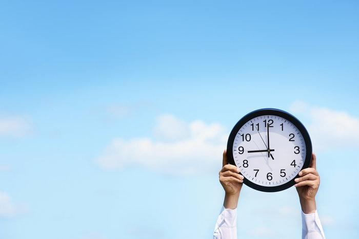 Person holding clock | Thrive Counseling Center